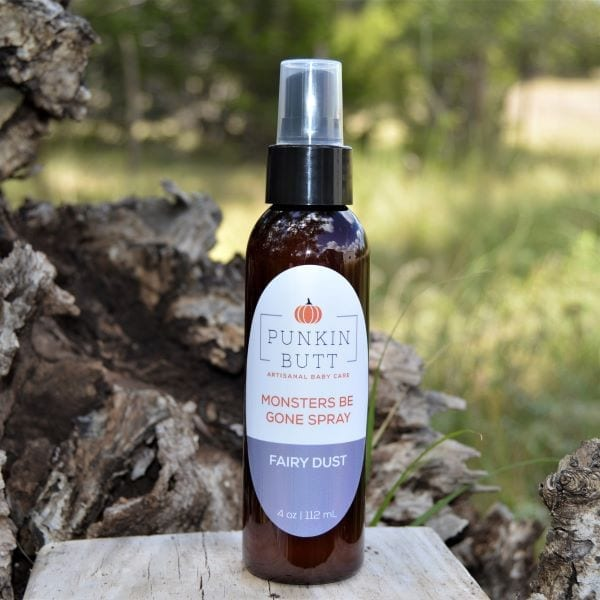 Image of a 4-ounce spray bottle of Punkin Butt Monsters Be Gone Spray on a picnic table